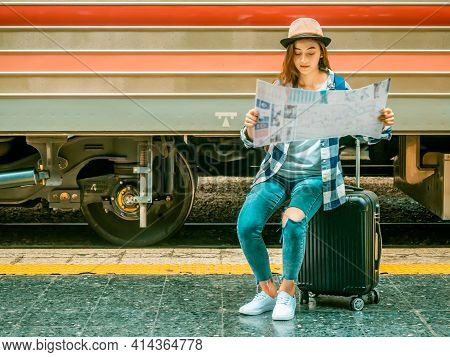 Travel Concept.beautiful Traveller Girl In Train Station.