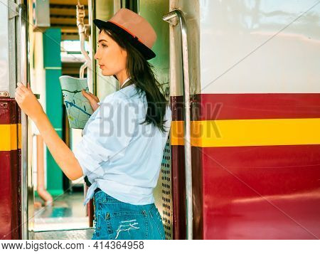 Travel Concept.beautiful Traveller Girl In Train Station.backpacker Pretty Woman Wear Hat Stepup To