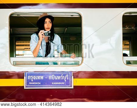 Travel Concept.beautiful Traveller Girl In Train Station.pretty Woman Wearhat Standing In Train Wind