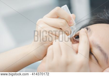 Woman Use Eye Drop, Artificial Tears To The Eye