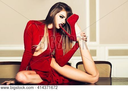 High Heels Concept. Sexy Fashion Young Woman Licking Heel