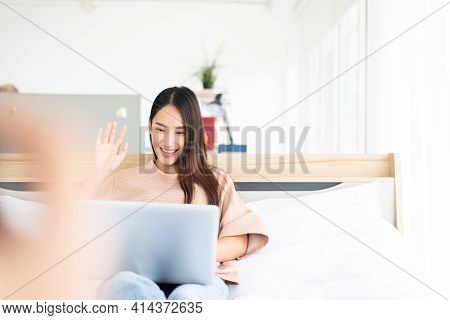 Beautiful Asian Woman Using Video Conference Call To People,work From Home,work At Home,new Normal C