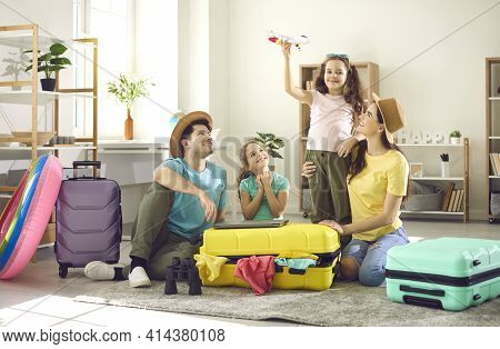 Happy Family With Children Preparing For Journey Going On Adventure Trip