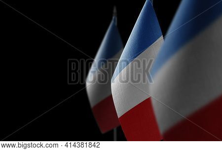 Small National Flags Of The France On A Black Background