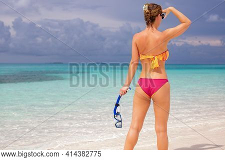 Woman Watching Sea Horizon On Tropical Island With Snorkel Gear. Sexy Woman Booty In Bikini Enjoying