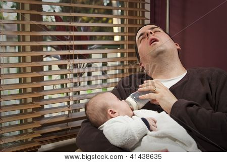 Exhausted Father Feeds Son