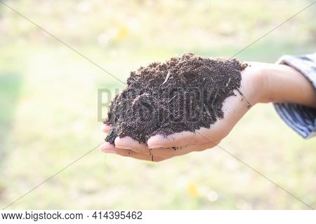 Hand Farmer Holding Fertile Soil On Dry Ground Blur. For Plant Replacement Trees. Saving Environment