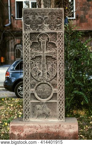 Grey Stone Khachkar With A Figured Arch Over The Cross, A Figure Of A Saint On A Horse And A Circle-