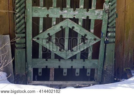 Old Carved Wooden Door Locked On Cable Lock, Outdoor Shot