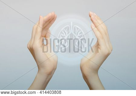 Two Female Hands Hold An Icon Of A Human Lung Organ. The Concept Of Fighting For Health, Against Pne