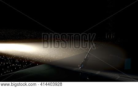 An Electric Guitar Resting On A Stand On A Music Concert Stage Lit By A Single Dramatic Spotlight Fa