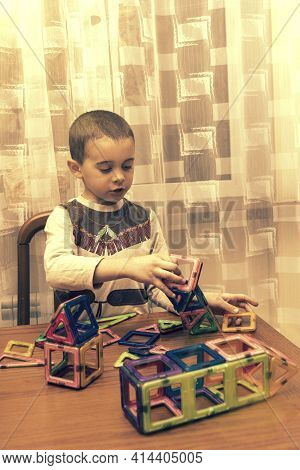 Little Smiling Boy Playing With Magnetic Constructor Toy. Cute Little Boy Playing With Colorful Magn