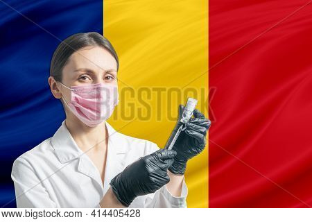 Girl Doctor Prepares Vaccination Against The Background Of The Romania Flag. Vaccination Concept Rom