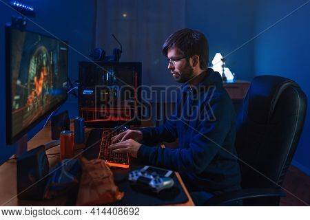 Concentrated Pro Gamer Playing Game, Taking Part In Online Tournament Sitting At Computer At Home. L