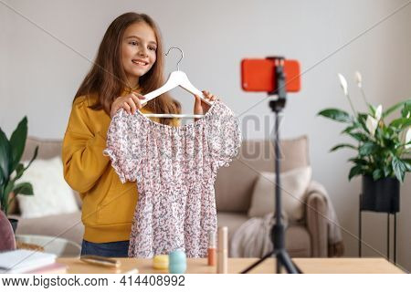Pretty Girl Fashion Blogger Recording Video On Smartphone At Home. Popular Kid Influencer Talking Ab