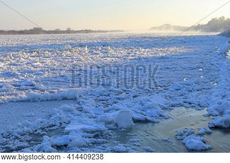 The First Rays Of The Sun Illuminate The Ice Drift On The River Neman In Winter