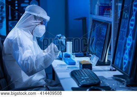 Doctor In Protective Suit Is Doing A Science Experiments And Developing Vaccine In A Modern Laborato