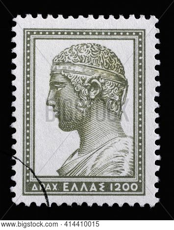 ZAGREB, CROATIA - SEPTEMBER 05, 2014: Stamp printed in Greece shows head of the charioteer of Delphi, circa 1954