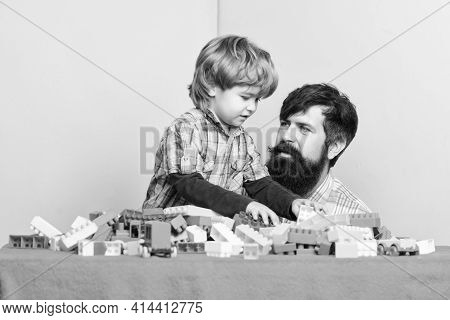 Little Boy With Bearded Man Dad Playing Together. Father And Son Play Game. Child Development. Happy