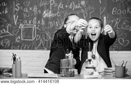 Little Girls In School Lab. Chemistry Education. Little Scientist Work With Microscope. Chemistry Re