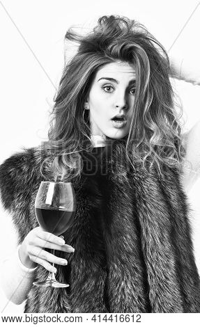 Fashion Model Long Hair Fur Coat Or Vest Hold Wineglass. Luxury Lifestyle Concept. Fashionable Lady