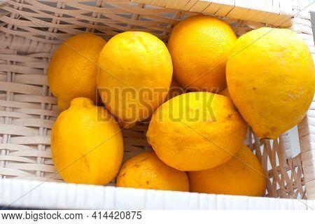 Fresh Lemon With Leaves. Lemon Tree. Box Of Yellow Lemons With Fresh Lemon Tree Leaves On Wooden Bac