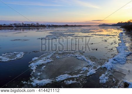 Ice Drift On A Wide River. Winter At Dawn