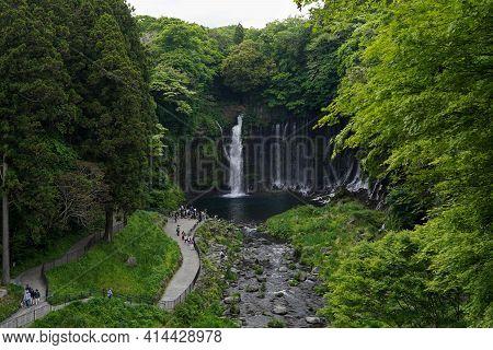 Fujinomiya,shizuoka,japan:06 May 2018: A Lot Of Tourists Sight Seeing In Front The Shiraito Falls Lo