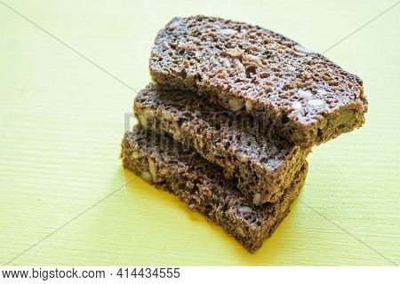 Brown Bread Slices Isolated On Light Background.slices Of Rye Bread.whole Wheat Bread Slices Grasped