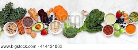 Set Of Healthy Food Ingredients. Top View Table Scene On A White Marble Banner Background. Super Foo