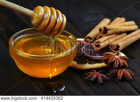 Honey, Cinnamon, Ginger And Anise On A Wooden Table. Honey In A Bowl And Spices.