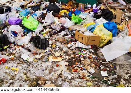 Garbage Pile In Landfill And Abundance Of Waste, Trash And Pollution Of Plastic Bottles And Bags On