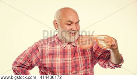 Optics Store. Carefree Emotional Pensioner Concept. Man Senior Bearded Hipster Wear Striped Sunglass