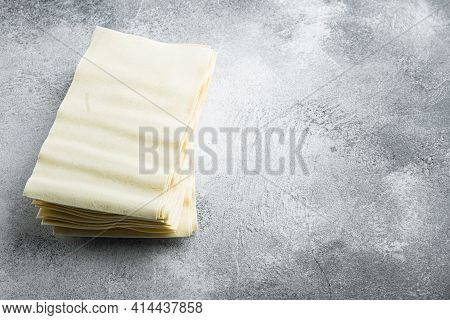 Uncooked Lasagna Sheets Set, On Gray Stone Background, With Copy Space For Text