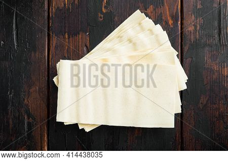 Dried Uncooked Lasagna Pasta Sheets Set, On Old Dark  Wooden Table Background, Top View, Flat Lay