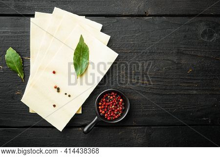 Lasagna Dough Sheets Set, With Seasoning And Herb, On Black Wooden Table Background, Top View, Flat