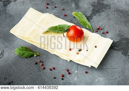 Organic Lasagna Pasta Sheets Set, With Seasoning And Herb, On Gray Stone Background, With Copy Space