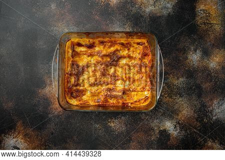 Classic Meat Lasagna With Cheese Bechamel And Bolognese Sauce Set, In Baking Tray, On Old Dark Rusti