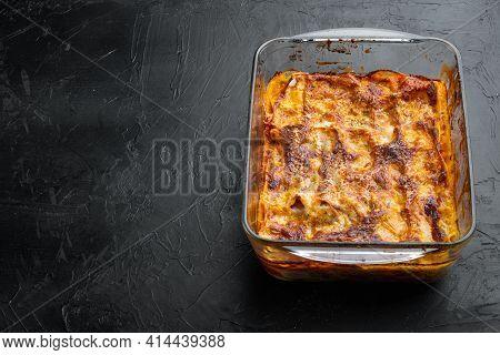 Italian Food. Hot Tasty Freshly Baked Lasagna Set, In Baking Tray, On Black Stone Background, With C