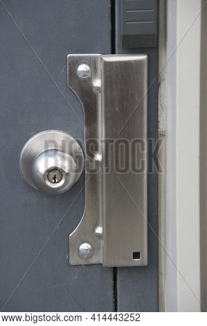 Door Latch Shield On The Edge Of The Door.    North Vancouver Bc Canada