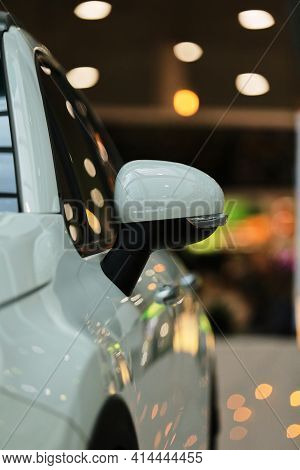 Mirrors, white car. Rear-view mirrors of a new white car with bokeh background. Rearview mirrors of