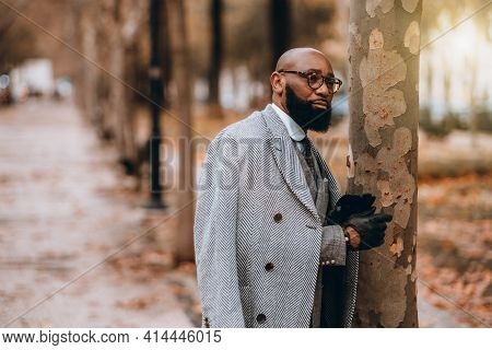 A Street Portrait With A Shallow Depth Of Field And Selective Focus On A Dapper Bearded Black Man En