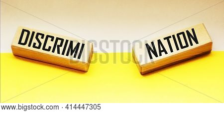 Discrimination Is A Wooden Block Word With Letters, Human Rights. Prejudice And Inequality. Racism.