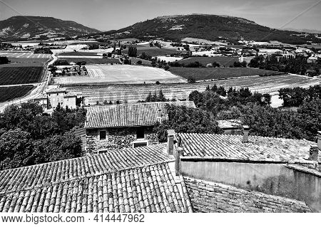 Roofs Of Stone Houses And A Mountainous Landscape In The Ardeche Area Of France, Monochrome