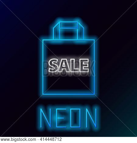 Glowing Neon Line Shoping Bag With An Inscription Sale Icon Isolated On Black Background. Handbag Si