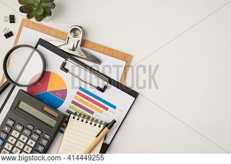 Top View Photo Of Business Workplace With Two Folders Pie Chart Diagram Plant Binders Magnifier Glas