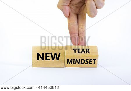 New Year And Mindset Symbol. Businessman Turns The Wooden Block And Changes Words 'new Mindset' To '