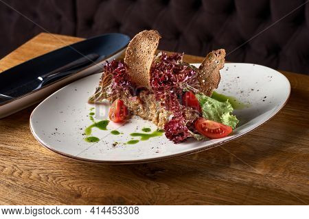 Exquisite Serving Restaurant Plate Of Eggplant Paste Decorated With Thin Slices Of Bread.