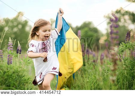 Ukraine's Independence Flag Day. Constitution Day. Ukrainian Child Girl In Embroidered Shirt Vyshyva