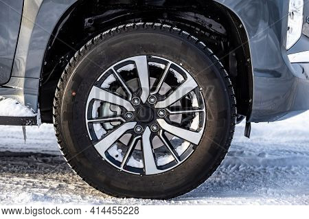 Wheel. Cast Wheel With Tires Close-up. Worn On An Suv. Winter, Snow On Wheels.